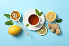 Flat Lay. Cup Of Tea, Lemon, Ginger, Mint, Honey And Dipper On Blue Background, Copy Space
