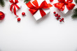canvas print picture - Christmas and New Year holiday background. Xmas greeting card. Christmas red ribbon gifts and ornaments on white background top view. Flat lay