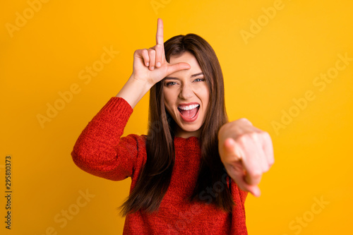 Canvastavla  Photo of cheerful rude ridiculous girlfriend pointing at you showing lose sign s