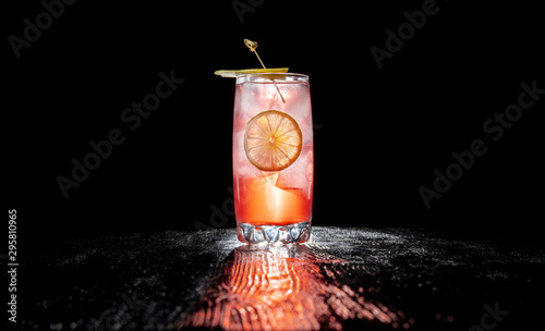 Fotomural Alcoholic cocktail with juice garnished with cherry and jalapeno pepper planted for a long time