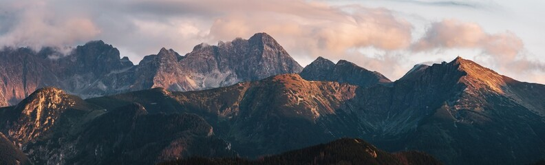 Mountain peaks at sunset. T...