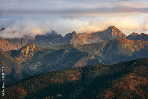 Fototapeta Mountain peaks in clouds at sunset. Tatra Mountains, Poland obraz