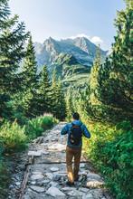 Man Walking On Hiking Trail In...