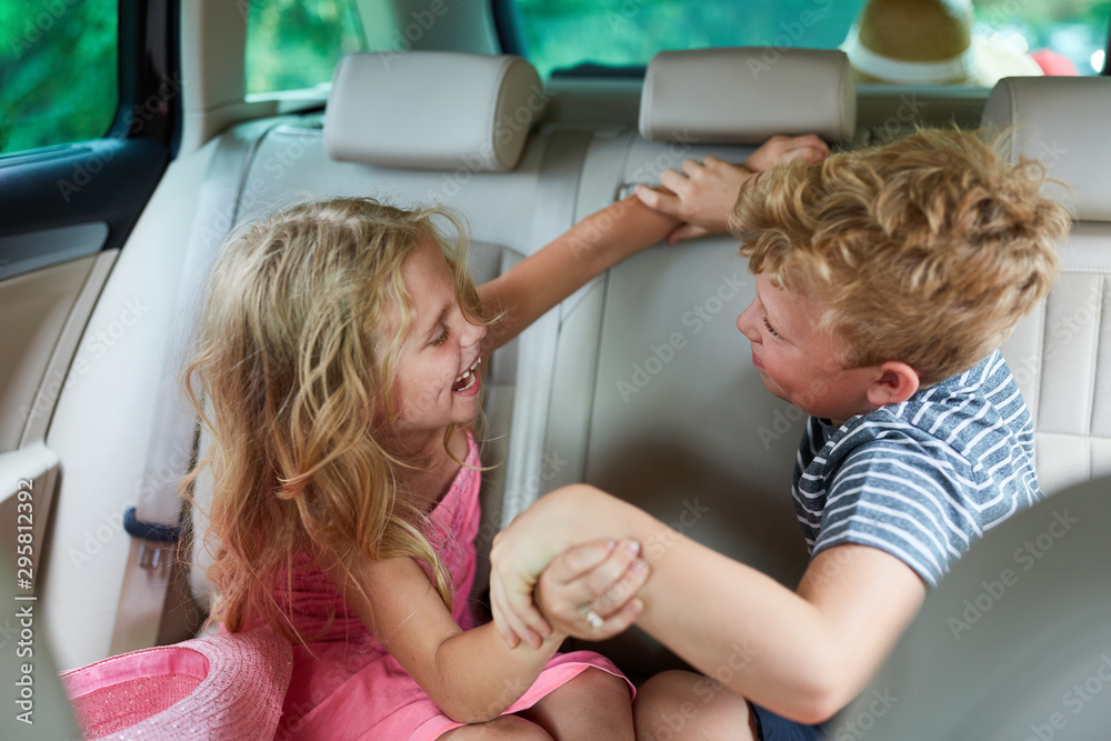Fototapety, obrazy: Siblings argue and fight in the car