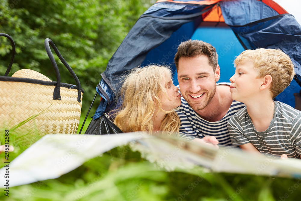 Fototapety, obrazy: Children give father a kiss while camping
