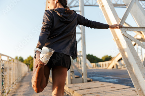 Fototapety, obrazy: Photo of african american slim woman using earpods and doing exercise