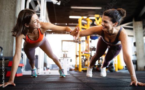 Fotobehang Fitness Beautiful fit people working out in gym together