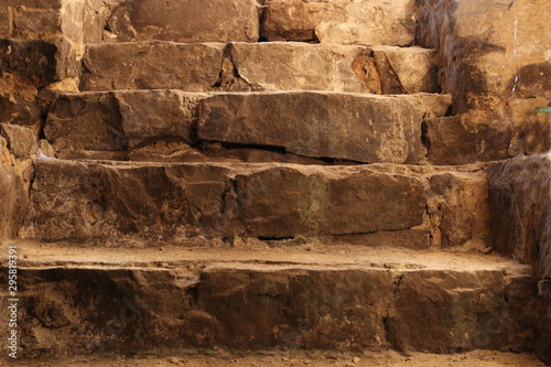 Stone stairs in the old fortress. Stone steps. Fototapet