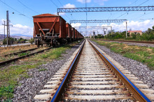 Railway Road And Old Freight Cars On Background.
