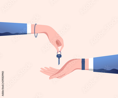 Hand of real estate agent gives house door keys to hand of customer Canvas Print