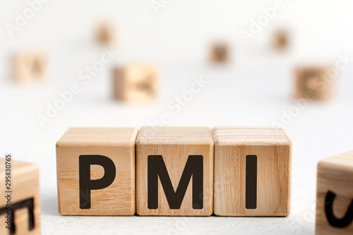 PMI - acronym from wooden blocks with letters, abbreviation PMI Private Mortgage Canvas Print
