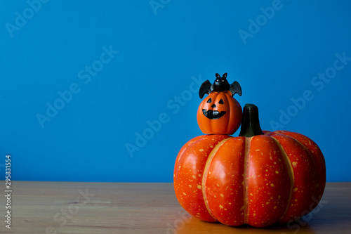Pumpkins on wood table. Halloween holiday background. - 295831554
