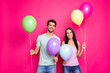 Leinwandbild Motiv Photo of cute guy and lady holding air balloons in hands came to first summer time party ready chill wear casual outfit isolated pink color background