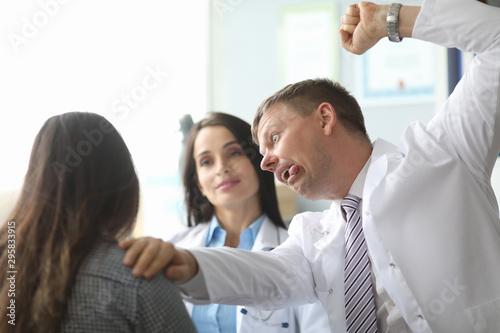 Fototapeta Doctor in medical office reports bad news obraz na płótnie