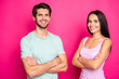 Leinwandbild Motiv Photo of self-confident couple guy and lady standing with crossed arms reliable workers wear casual clothes isolated vibrant pink color background