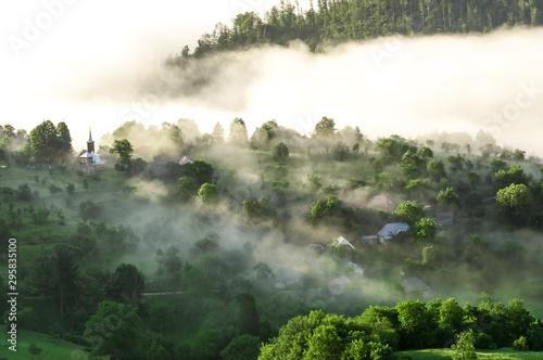 Poster Kaki Beautiful scenery landscape sunrise foggy morning village Maramures Romania