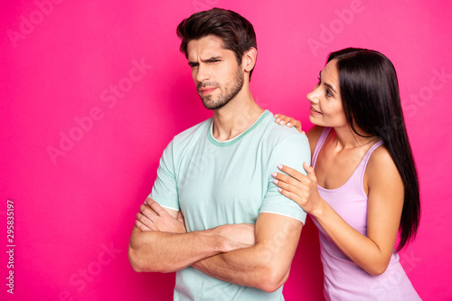Photo of funny couple guy blaming lady in cheating standing angry and mad waitin Wallpaper Mural