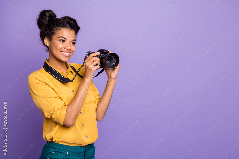 Fototapety, obrazy: Photo of pretty dark skin lady holding photo digicam in hands photographing foreign sightseeing professional wear yellow shirt trousers isolated purple color background