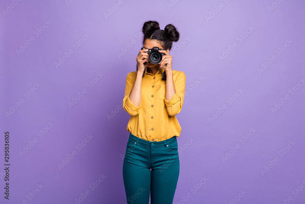 Fototapety, obrazy: Photo of amazing dark skin lady holding photo digicam in hands photographing foreign sightseeing abroad wear yellow shirt trousers isolated purple color background