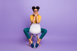 Leinwanddruck Bild - Full length photo of amazing dark skin lady sitting cozy on chair looking positive on camera wear specs yellow shirt trousers isolated purple color background