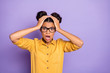 Leinwanddruck Bild - Photo of amazing pretty dark skin lady holding hands on head not believe awful bad news open mouth wear specs yellow shirt isolated on purple color background