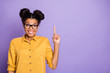 Leinwanddruck Bild - I have plan. Photo of amazing dark skin lady indicating finger empty space intelligent person creative idea wear yellow shirt isolated purple color background