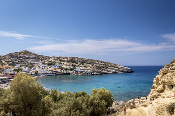 The sea coast and mountains of Matala on a clear summer sunny day. Crete, Greece.