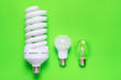 canvas print picture - Set of different energy saving lamp on green background.