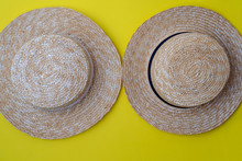 Modern Stylish Boater Straw Hats On A Yellow Background.Trip, Travel And Tourism Concept. Space For Text.