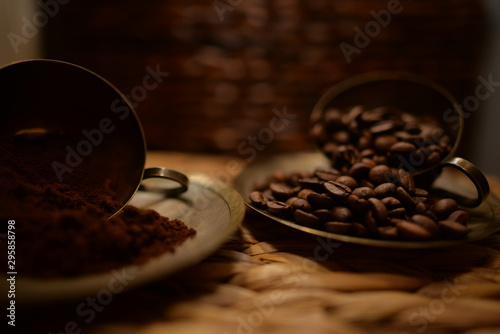 Fototapety, obrazy: cup of coffee and beans on wooden background