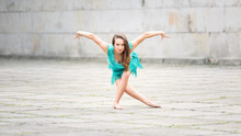 A Woman Dancing In An Empty Sq...