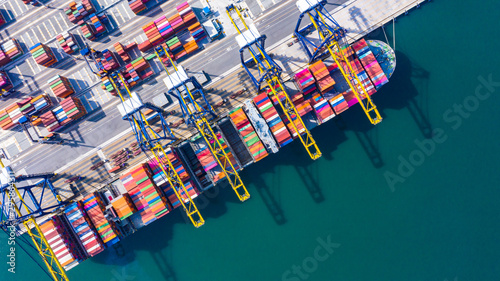 Container cargo ship  loading in a port, Aerial top view container cargo ship Wallpaper Mural