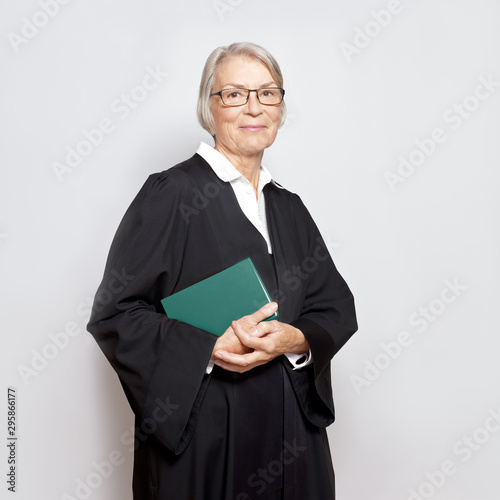Best legal advice concept: portrait of a friendly smiling mature judge with law Tapéta, Fotótapéta