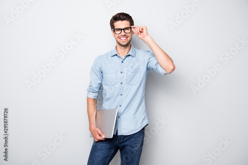 Photo of cheerful handsome attractive clever man smiling toothily holding laptop Poster Mural XXL