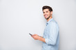 Profile side photo of positive cheerful man using holding his mobile phone have online conversation with friends on social media at copyspace wear stylish outfit isolated over grey color background