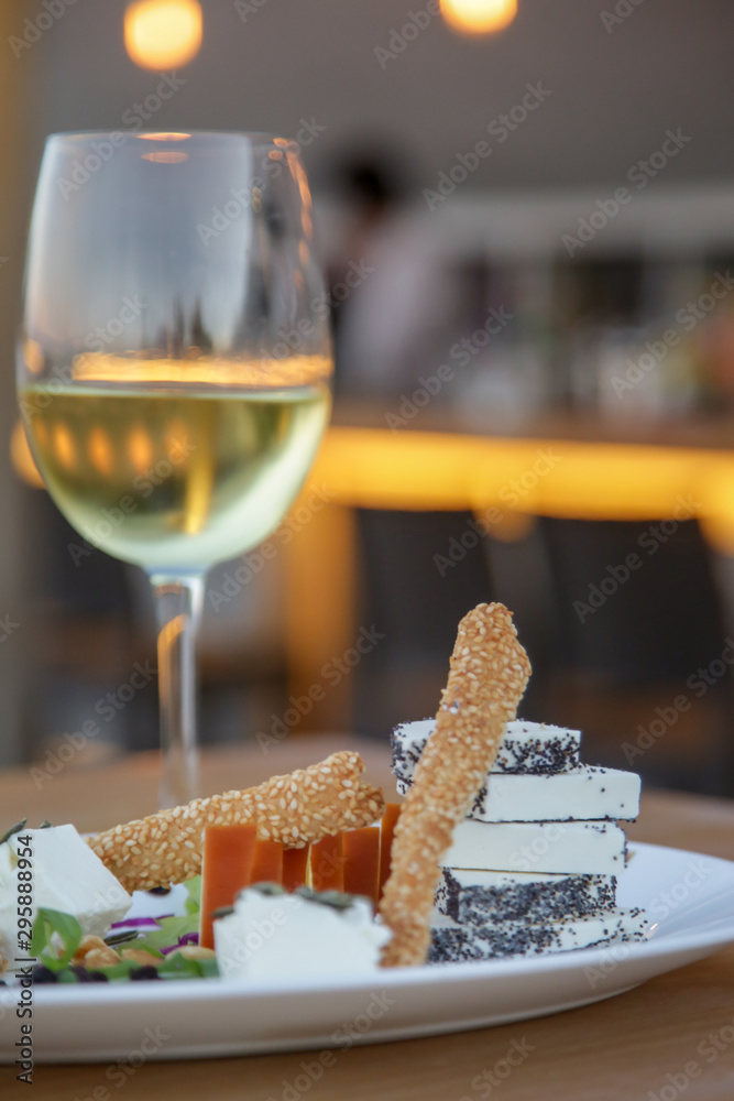 Fototapety, obrazy: Simply  hand-picked cheese platter of artisan cheeses fruit and nuts with a glass of white wine