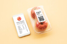 Nutrition Information Of Organic Fruit With Apple In Packaging And Data From Qr Code On Smart Phone.food And Healthy Concepts