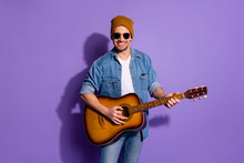 Photo Of Cheerful Attractive Trendy Handsome Cool Nice Guy Holding Guitar With Headwear Hands Playing Musician Instrument Isolated Over Vibrant Color Purple Background
