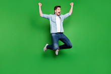 Full Body Photo Of Handsome Guy Jumping High Sportive Competition Participant Celebrating First Place Champion Wear Casual Denim Clothes Isolated Green Color Background