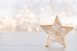 canvas print picture Christmas star, decor on bokeh silver background. Christmas or New Year minimal concept.