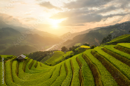 Montage in der Fensternische Beige Aerial top view of paddy rice terraces, green agricultural fields in countryside or rural area of Mu Cang Chai, Yen Bai, mountain hills valley at sunset in Asia, Vietnam. Nature landscape background.