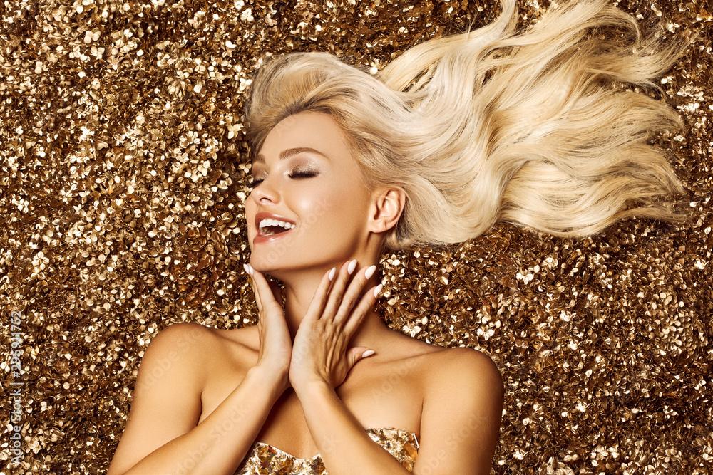 Fototapeta Beautiful blonde woman in golden flowers garden