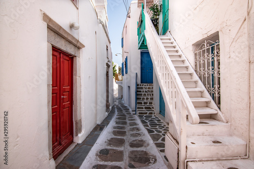 Narrow street in town centre of Mykonos, Greece.