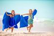 Leinwandbild Motiv Little girls having fun enjoying vacation on tropical beach
