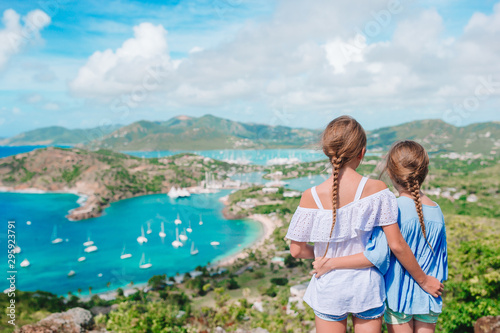 Adorable little kids enjoying the view of picturesque English Harbour at Antigua Canvas Print