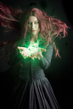 Victorian Witch Holding A Glowing Orb. This Is A Digitally Composited Image
