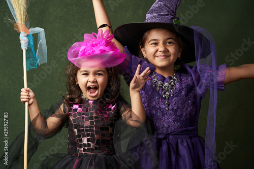 Fotografija Cute child girl in witch costume for Halloween, close-up