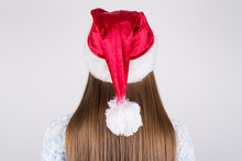 Back Rear Behind Close Up Photo Portrait Of Charming Gorgeous Lady Having Nice Straight Smooth Silky Hair Wearing Santa's Hat On Head Isolated Grey Background