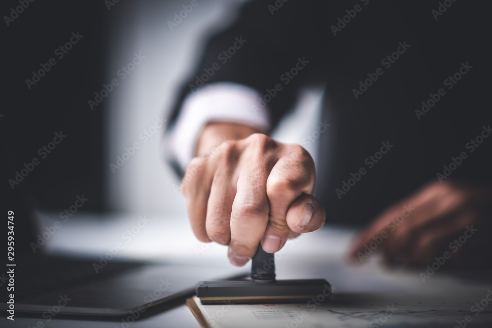 Fototapety, obrazy: Close-up Of A Person's Hand Stamping With Approved Stamp On Text Approved Document At Desk,  Contract Form Paper