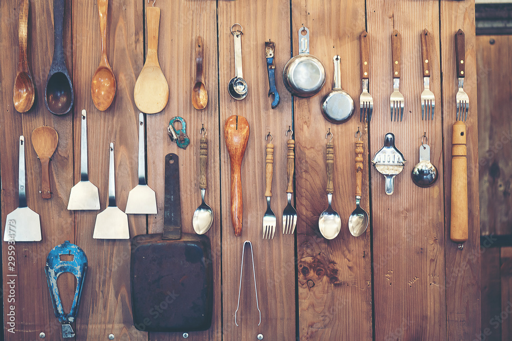 Fototapety, obrazy: Cutlery  ladle and kitchen accessories Hanging on a wooden wall